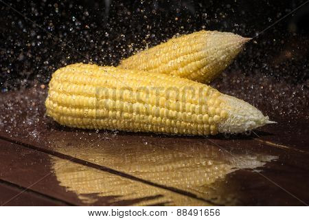 Fresh Sweet Corn On Wooden Table.