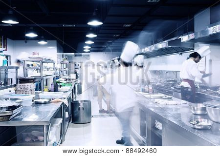 modern hotel kitchen and busy chefs.