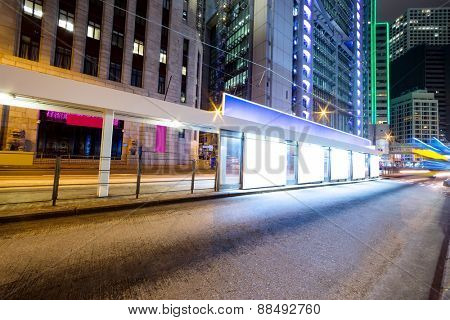 traffic light trails nearby bus stop