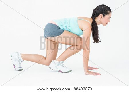 Attractive woman ready to run on white background