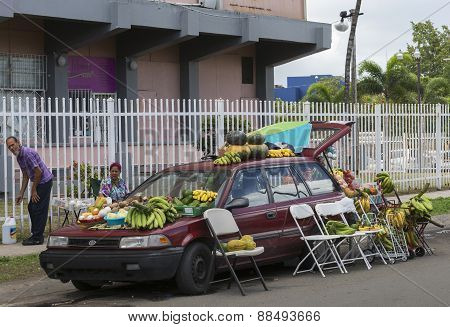 Farmer Sells Fruit Out Of His Car.