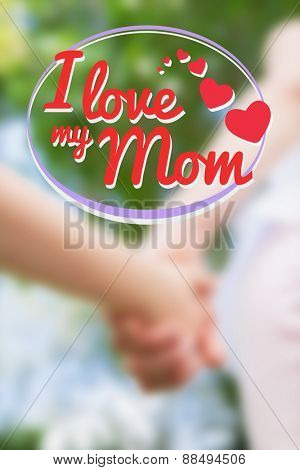 mothers day greeting against mother and daughter holding hands