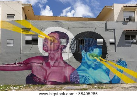 Graffiti Of Pink Woman And Blue Woman Beaming Light.
