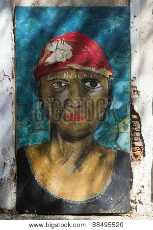 Graffiti Of Female Brown Face With Red Bandanna.