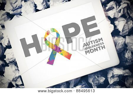 autism awareness month against tablet pc