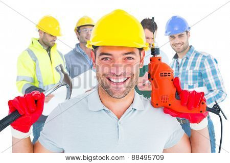 Composite image of happy repairman holding hammer and drill machine