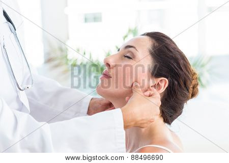 Doctor examining her patients jaw in medical office