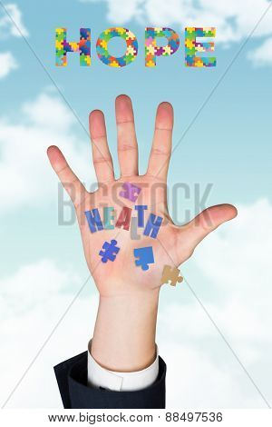 Hand with fingers spread out against blue sky