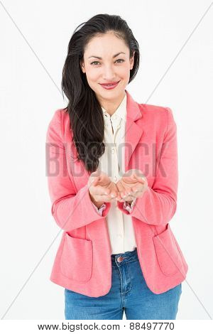 Elegant brunette showing with her hands on white background