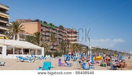 Tourists Relaxing On The Beach Of Calafell, Spain