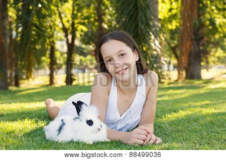 Cute Beautiful Smiling Teen Girl With White And Black Baby Rabbit