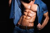 stock photo of hunk  - Muscular and sexy body of young sport man in jeans shirt with perfect abs - JPG