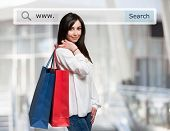pic of shopping center  - Young woman holding shopping bags in front of a search bar - JPG