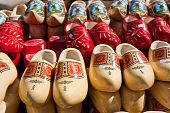 image of clog  - Famous traditional Dutch wooden clogs on display for sale - JPG