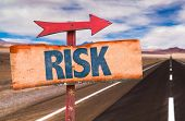 picture of risk  - Risk sign with road background - JPG