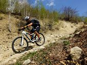 foto of descending  - man descending a steep trail downhill style - JPG