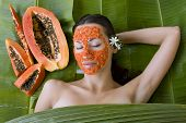 picture of facial  - Beautiful caucasian woman having fresh papaya natural facial mask apply skin care and wellness - JPG