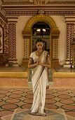 foto of sari  - Beautiful young indian woman in traditional clothing with bridal makeup and oriental jewelry - JPG