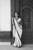 picture of indian sari  - Beautiful young indian woman in traditional clothing with bridal makeup and oriental jewelry - JPG
