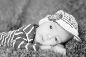 stock photo of knitted cap  - cute newborn baby in knitted cap  - JPG