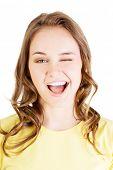 picture of blinking  - Portrait of happy woman blinks her eye - JPG