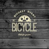 picture of bicycle gear  - Bicycle badges logos and labels for any use on wooden background texture - JPG