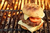 picture of bbq party  - Homemade BBQ Beef Burger On The Hot Flaming Grill. Good Snack For Outdoors Summer Party Or Picnic