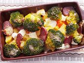 picture of baked potato  - Brocolli and potato casserole in a baking dish on the table - JPG