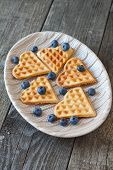 Постер, плакат: Waffles And Blueberries On A Wooden Background