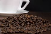 picture of coffee crop  - Coffee crop spilled in front of a white coffee cup