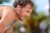 pic of breathing exercise  - Tired exhausted man runner sweating after cardio workout - JPG