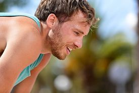 foto of cardio exercise  - Tired exhausted man runner sweating after cardio workout - JPG