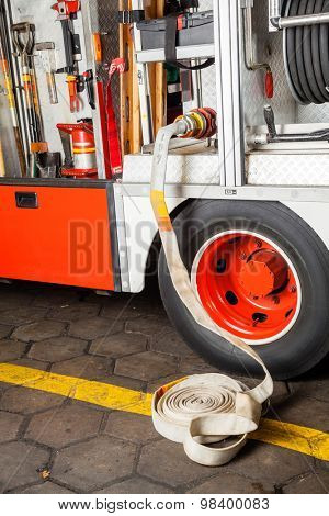 Water hose connected to truck at fire station
