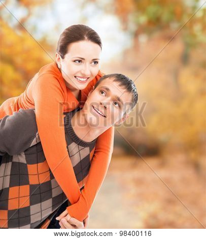 A beautiful couple enjoying being together in the autumn park.