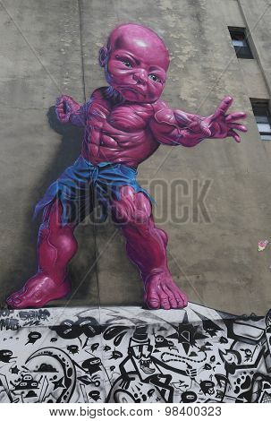 New giant pink Temper Tot mural by Ron English in Little Italy in Manhattan.