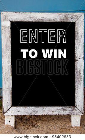 Enter To Win Message Written On Vintage Chalkboard