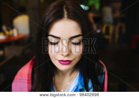 Close-up portrait of young closing eyes woman