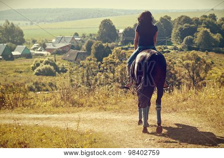 Woman During Horseback Riding The Summer In The Countryside.