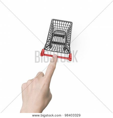Woman Forefinger Pushing Small Empty Shopping Cart High Angle View