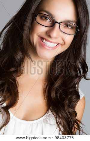 Beautiful young brunette woman wearing glasses