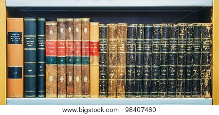 Old Vintage Books On Wooden Shelfs In Library