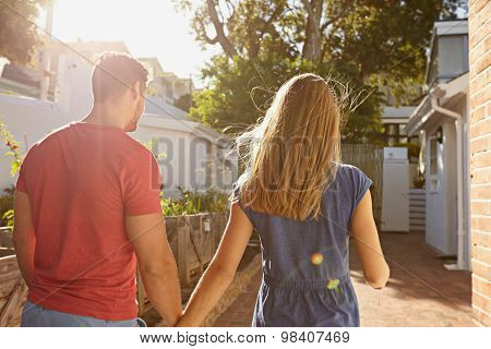 Young Couple Walking At Their House Together