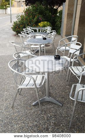 Metal tables and chairs outdoor of restaurant.