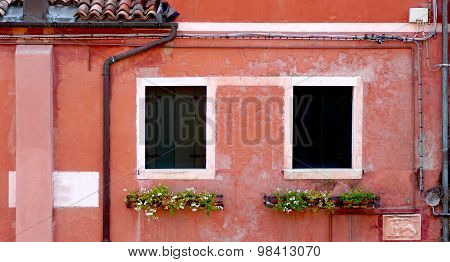 Two Windows And Drained Pipe With Coral Color Wall