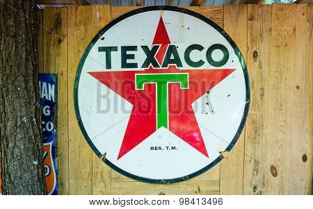 Old Texaco Sign On Wood Wall