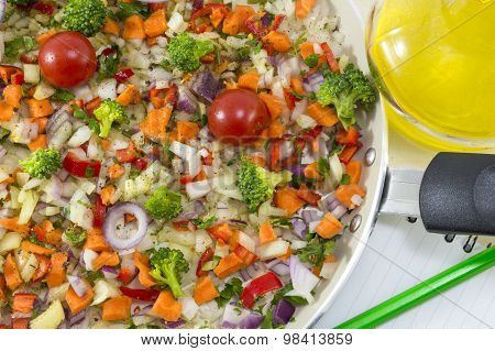 Vegetable Salad On A Cooking Pan Next To A Open Notebook And A Pen For Writing Recipe. Vegetables Re