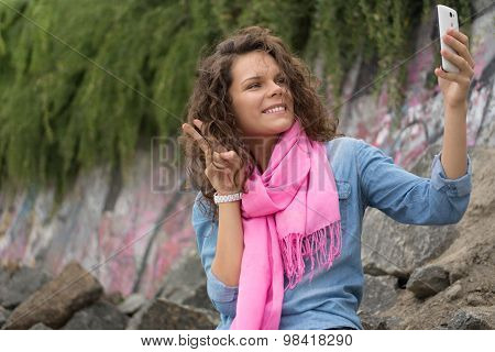 Young Happy Beautiful Smiling Woman Making Self On Camera Phone
