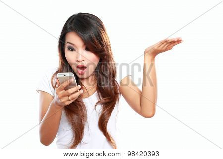 Face Expression Of Young Woman Reading A Text Message On Mobilephone