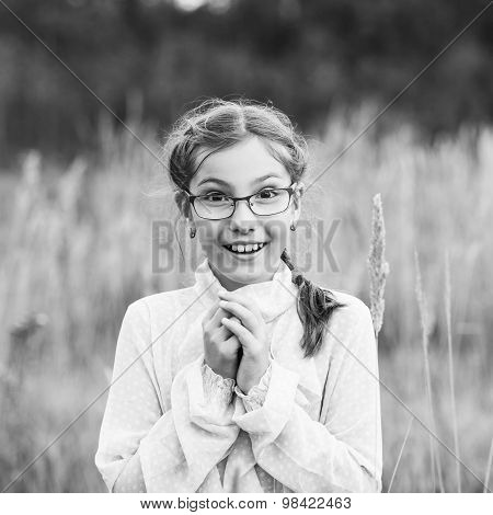 Adorable girl in glasses