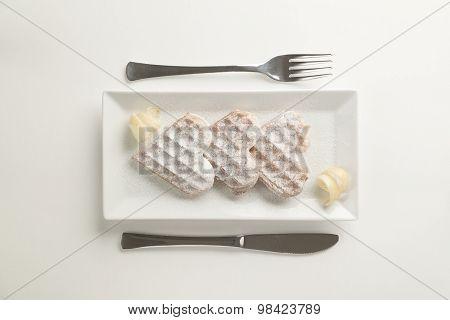 Heart Waffles Lemon Zest, Powdered Sugar Served On Rectangular Plate
